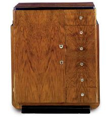 AN ART DECO PALISANDER AND EBONZIED CABINET,  CIRCA 1930  40in. (102cm.) high, 33in. (84cm.) wide, 16½in. (42cm.) deep