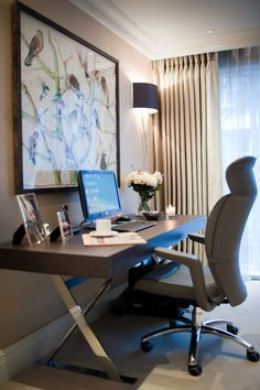 Sophisticated home office with large, contemporary desk and ergonomic chair.
