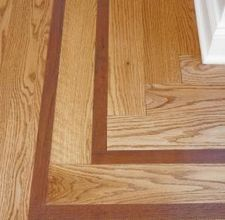 Different wood floors in house with different installation for Hardwood floor borders ideas
