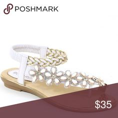 """🌸 Toe ring white floral rhinestone SANDAL 🌸 If you love bling & you love sandals, you are bound to fall in love with this """"toe ring"""" design WHITE & GOLD rhinestone floral SANDAL.  Vegan materials make up these Italiana sandals.  They are elegant and a beautiful brass gold toe decor adorns the front of the sandal.  All rhinestones are secure and well fit.  The back elastic is light on the heel.  The plastic between the toes is soft, but if not soft enough, just snip it off.  Fall in love…"""