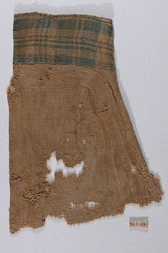 Sleeve Fragment with Plaid Cuff Object Name: Fragment Date: 4th–9th century Geography: Egypt Culture: Coptic Medium: Linen; plain weave Dimensions: 8 3/4 in. high 6 7/16 in. wide (22.3 cm high 16.4 cm wide) Classification: Textiles