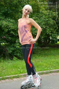 Street fashion. Random photo. Moscow, Russia. Rollers, black tights and orange T-shirt. odigif@gmail.com photo.