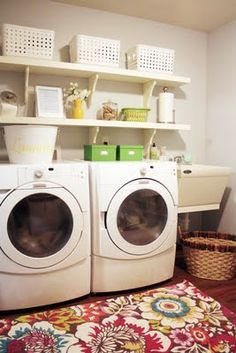 shelves above the washer and dryer, bins or baskets on top shelf