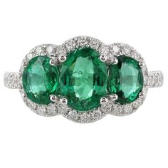 Triple  Oval Emerald Diamond Gold Halo Ring   From a unique collection of vintage more rings at https://www.1stdibs.com/jewelry/rings/more-rings/