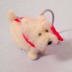 Westie with Red Scarf www.teeliesfairygarden.com Some fairies make red scarfs for their dogs, just like what the fairy owner of this Westie did for him. So cute! #fairydog