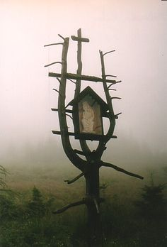 The Dark Witch left this shrine at the edge of her property.  But I've never seen birds nest there.  Can't blame them...