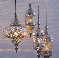 Morocco's old world eclecticism and dye-drenched hues of a sunnier disposition add a bit of warmth and interest where ever you need it. Moroccan flare can come in the shape of a fantastically silhouetted hanging lantern with fun geometric cut outs.