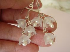 these lucite tulip earrings also resemble the bell shaped flowers from the strawberry tree.  from Gogobeads