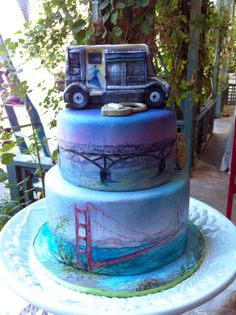 2 tier custom San Francisco wedding cake complete with hand painted golden gate bridge and food truck that was important to the bride and groom
