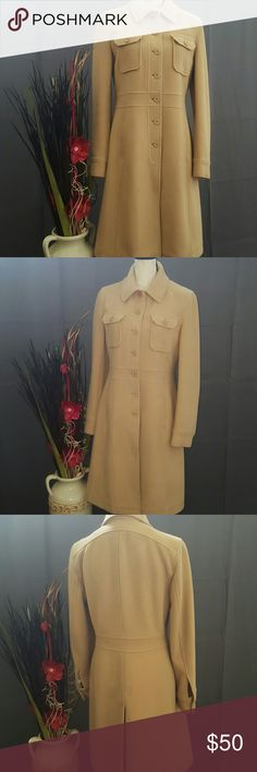 """DKNY Long Peacoat Wool Blend Coat Worn only a few times.  Excellent condition. No snags, stains, tears or piling.  Front button closure, 2 pockets • Fully lined inside • Extremely comfortable, warm & flattering  I am selling this gorgeous coat because I moved to Florida and can no longer wear it. 50% wool, 50% viscose • Approx length is 39"""" DKNY Jackets & Coats"""