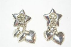 VINTAGE STERLING SILVER 925 EARRINGS BIG PUFFY STAR HEART DANGLE CHAIN JEWELRY !                            Seller information  justinsublime (1247  )      100% Positive feedback  Save this seller  See other items     AdChoice  Item condition:Pre-owned  Time left: 6d 22h (Nov 23, 2012 17:55:41 PST)  Starting bid:US $0.99  [ 0 bids ]