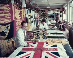 All by hand: Artists creating flags and banners for the Coronation of Queen Elizabeth II at Edgington's factory in Sidcup, London