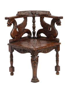 A Renaissance Revival Carved Oak Corner Chair.