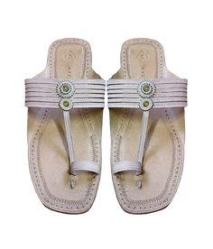 It's not just about staying royal, it's also about style and fashion. All those noble style and royal fashionist men who like maintaining their panache might want to pick up a pair of Kolhapuri sandals exclusively designed for them out of pure leather and enhanced with wonderful design. These sandals called as kolhapuri chappal are designed with elegance and they deliver the style and comfort.    Product Description and Care:    Natural color, punching design leather sandal for men. It has…