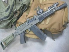 Rifle Dynamics AK rifle Chambered in 5.45x39 with an Ultimak gas tube, and a Bulgarian 4 piece flash hider.
