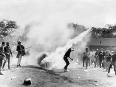 1968: Protesters lob back tear gas canisters thrown by police in Grant Park.