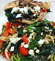 stuffed chicken and zucchini noodles with sautéed spinach, cherry tomatoes and feta served with a balsamic reduction. That's right, I made a balsamic reduction. I'm fancy. #noms #food #iifym #dinner #foodatwork #fancyfood #healthychoices #yummy  #bikini #competitor #fitness #fitspiration #fitgirl #bikini #bikiniathlete #bikinimodel #girlswithmuscle #girlswholift