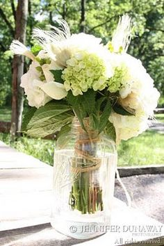 Take the twine that was used to hold  the flowers in their packaging and tie it around the stems before placing them in the vase. A great way to keep your blooms in their arrangement and add unique look to  your center piece.