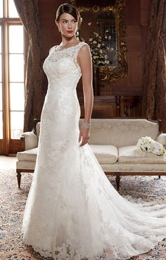 Casablanca 2004 is a gorgeous lace dress with an off the shoulder neckline. With a lace applique over tulle, the scalloped neckline is a detail sure to take everyone's breath away. Let this fit and flare, A-line make a statement at your wedding.