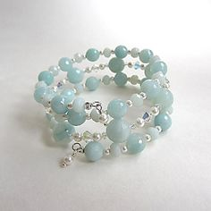 Serenity II: Seafoam color Chinese Amazonite gemstone memory wire bracelet  accented with iridescent Swarovski crystals and white crystal.  $45.00 https://www.etsy.com/listing/220178610/seafoam-color-chinese-amazonite-memory