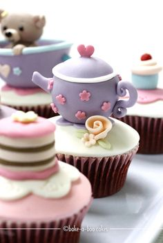 Another tea party puppy cupcakes :) by Bake-a-boo Cakes NZ, via Flickr