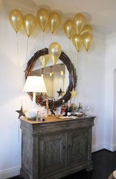 Easy Decorations for an Academy Awards Party with golden balloons and stars.