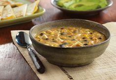 This ultra-flavorful soup is worth the wait...the slow cooker makes it easy, and the savory combination of chicken, beans, corn and picante sauce makes it absolutely delicious!