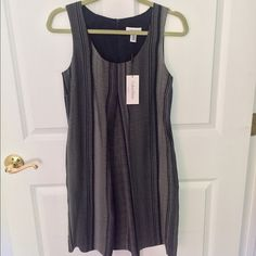 Navy blue and white printed dress by Calvin Klein Navy blue and white thin striped A-line dress with pockets, never worn, still has tags Calvin Klein Dresses