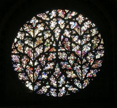England Lincoln Cathedral, the Bishop's Eye. Fragments of ancient glass in a Flowing Gothic window.