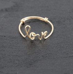 Words have the power to bring life and transformation! What we choose to wear can be a significant expression of who we are, who or what we love, and what we believe. This beautiful precious metal word ring is custom handcrafted and designed as a special gift for you or someone in your life. Select from the provided words or the custom option to choose your own word. Please note that custom choices will be reviewed before production. Each item is made to order using only lowercase letters. Word Diy Wire Jewelry Rings, Wire Jewelry Making, Wire Jewelry Designs, Handmade Wire Jewelry, Handmade Rings, Jewlery, How To Make Rings, Diy Rings Easy, Wire Wrapped Rings
