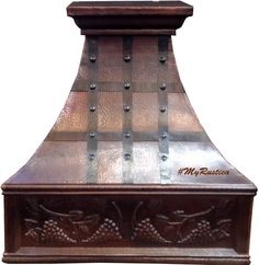 Custom copper vent hood with an apron decorated with hand punched grapes. #copperhood #rangehood #mycustommade