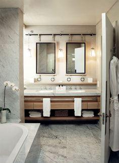 Mirrors + towel bar in chic bathroom design