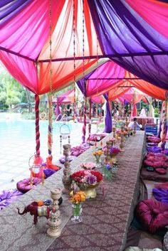 #Moroccan Wedding~ Purple, orange and pink wedding reception decor and tablescape #purple #orange #pink #wedding ##reception #weddingreception #decor #receptiondecor #tablescape