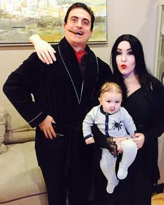 Halloween costumes for Parents wearing Baby Carriers on All Hallows Eve - Hike n. - Halloween costumes for Parents wearing Baby Carriers on All Hallows Eve – Hike n Dip Halloween co - Addams Family Halloween Costumes, Best Group Halloween Costumes, Pregnant Halloween Costumes, Gomez, Baby Carriers, Hallows Eve, Girls, Parents, Dip