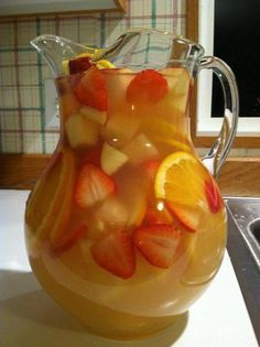 Pineapple Lemonade Sangria...perfect for those summer parties. Follow link under pic. For recipe