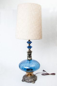 Love this lamp - except for cherubs.  Great color!! Vintage EF & EF Industries Blue Glass Lamp with by TheVintageRhino, $89.00