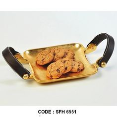 Metal Tray With Leather Handle - Small Our products are made to order.We do not keep ready stock. This aluminium serving tray is finished with gold/brass finish.Handmade.Superfine Handicrafts can customize finish as per buyer requirements.For wholesale trade inquiry,please e-mail us info@sfhindia.com