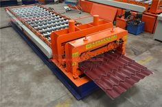 #Glazed #tile #steel #sheet #roll #forming #machine cutter portion is driven by a hydraulic cylinder to move up and down the tool, you can put color steel cut off. Glazed tile steel sheet roll forming machine production process is as follows: color steel roller into the molded part after molding to-pressure part, pressed into an equidistant one, the cutter is responsible for cutting to length. Steel Roof Panels, Black Side Bag, Roll Forming, Hydraulic Cylinder, Steel Roofing, Glazed Tiles, Steel Sheet, Cold Rolled, Steel Structure