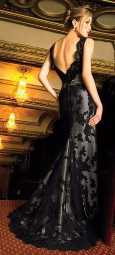 Elegant and sexy. This gorgeous mermaid style gown is a sheath of silver satin with gorgeous, black French lace over top. The deep v-neck…