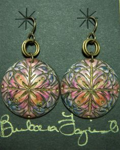 Barb Fajardo's series of mandela earrings. I believe these are carved polymer clay with gold leaf in the carved sections.... and it looks like alcohol inks?