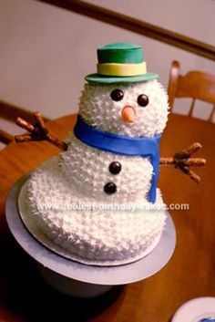 Homemade 6th Birthday Snowman Cake: I used two different Wilton pans to bake this 6th Birthday Snowman Cake. The bottom was baked in a soccer ball pan and the top in a 3D bear pan. I used