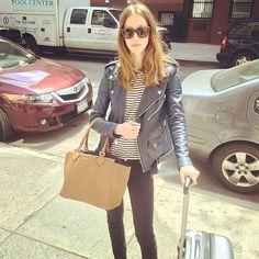 Model Alana Zimmer carrying her Michael Kors Miranda hangbag on her way to Shanghai. May 2014