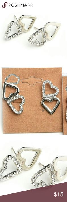 """NWT SILVER & GOLD DOUBLE HEART CRYSTAL STUDS NWT brand new in original packaging selling retail Silver & Gold double heart iridescent clear crystal rhinestones stud earrings Post backing Gold & Silver hearts Length from end to end: 1"""" Adorable gift for the holidays! Bundle & save! Jewelry Earrings"""