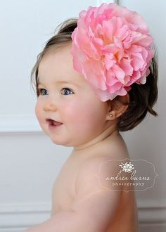 Who says you can't put gigantic flowers in little babies hair?  Looks darling!