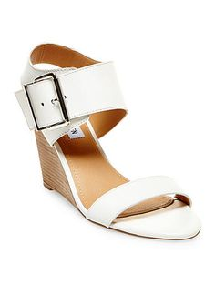 Walk tall with these Steve Madden Winston sandals! The wedged heel and silver oversized buckle add the perfect touch of fashionable flair to any look.