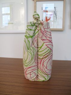 How to wrap wine bottles in a cloth for gifting.