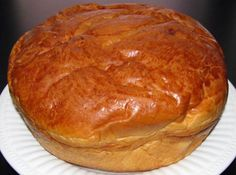 """No where else can make a sweet bread loaf like my hometown of Fall River, MA. It is a traditional recipe that is known to be brought over from the immigrants of São Miguel. This bread is most popular at Easter, but enjoyed year round. I like to have mine for breakfast with a little butter added on it. But, it is also served for dessert. This recipe is adapted from my local paper for """"Easter sweet bread"""". For the holidays, a boiled egg is placed in the center of the loaf. I remembe..."""