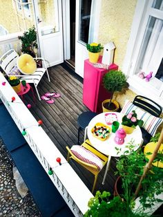 Accessories & Furniture,Stunning Small Balcony Design Ideas With White Wooden Railing And Rustic Light Yellow Wall Paint Combine With Vintage Wooden Flooring And White Round Table Featuring White, Black And Yellow Iron Chair Complete With Colorful String Lamps And Greenery,Interesting Small Balcony Design Ideas