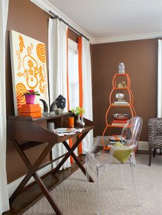 Chocolate walls, a mixture of design styles and pops of orange make for a visually interesting space.