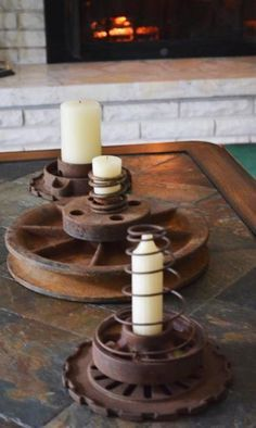 """Marie Niemann says, """"I love this big pulley as a centerpiece! I just stacked some assorted John Deere old farming implements and 'wala,' I have instant candle holders."""